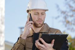 Construction agent relaying information. Construction agent relaying the information Stock Photography