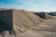 Construction aggregate and gravel dumps at concrete production p. Lant. Side view Stock Photography