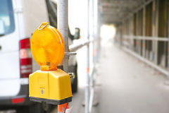 Construction ahead. Warning sign on a scaffolding that there is an construction site ahead - copy space to the right stock photography