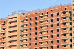Construction of an apartment building against the blue sky Stock Photo