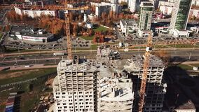 Construction of an apartment building in the city center. MINSK, BELARUS - OCTOBER 20, 2017: Aerial shot. Construction of an apartment building in the city stock video footage