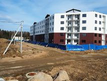 Construction of an apartment building. Construction of modern housing for different people. Details royalty free stock image