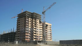 Construction of apartment buildings. Cranes work stock video