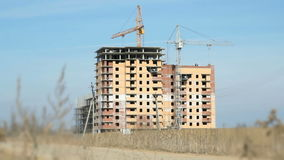 Construction of apartment buildings. Cranes work stock video footage