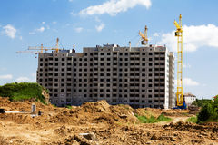 Construction of an apartment house. The platform, on which is under construction a new building for residing the people and for office Royalty Free Stock Photo