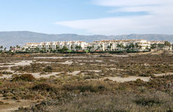 Construction of apartments. In Roquetas de Mar in the Spanish province of Almeria desert surrounded taverns. mountains in the background are seen on a sunny day Royalty Free Stock Photography