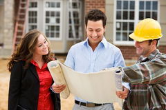 Construction: Architect Reviews Plans with Builder royalty free stock photos
