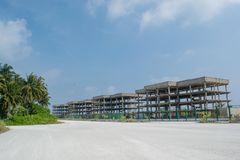 Construction area with multi-storey buildings at the tropical island. Construction area with multi-storey buildings located at the tropical island Maamigili in royalty free stock image