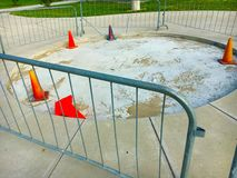 Construction. A construction area surrounded by fencing and cones Stock Photo