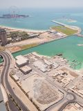 Construction of an artificial island Palm Jumeirah with construction equipment in Dubai. royalty free stock photo