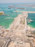 Construction of an artificial island Palm Jumeirah with construction equipment in Dubai. stock photo
