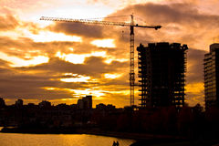 Construction au coucher du soleil Photographie stock