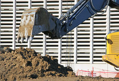 Construction Backhoe Bucket Digging a Hole Stock Photo