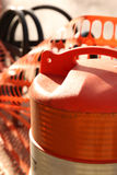 Construction Barrel Downtown Grand Rapids. Orange and white barrel with orange snow fence stock photo