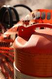 Construction Barrel Downtown Grand Rapids. Orange and white barrel with orange snow fence royalty free stock image