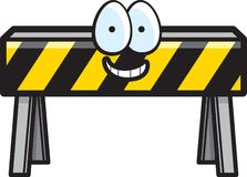 Construction Barricade. A yellow and black construction barricade smiling Royalty Free Stock Images