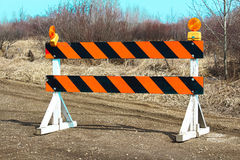Construction barricade along a country road Royalty Free Stock Image