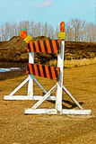 A construction barricade on a gravel road Stock Photography