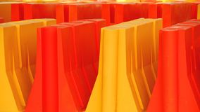 Construction Barriers. Yellow and orange construction barriers in colorful rows Stock Photos