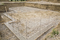 Construction basement footings rebar excavated. Concrete footings with rebar is ready for cement basement walls on background construction site Stock Photo