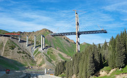 Construction of the big bridge in mountains. The high under construction bridge among mountains Stock Image