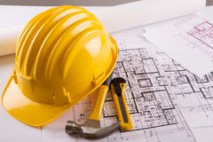 Construction blueprint. Blueprint for construction work with helmet and tools royalty free stock images