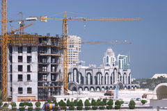 Construction boom. Construction under way in the New District of Doha, the capital of Qatar. Late 2004 royalty free stock images