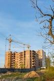 Crane build multi-storey residential house. Construction of brick house multi-storey residential building. crane build multi-storey residential house. Modern Stock Image