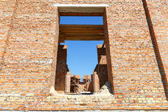 Construction of a brick house. Seen through the windows building interior Royalty Free Stock Images