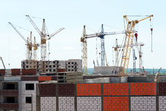 Construction of brick houses. View construction of brick houses with cranes Stock Photography