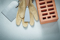 Construction brick protective gloves paint scrapers on concrete Stock Image