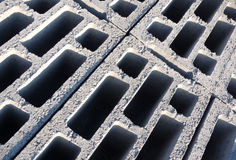 Construction Bricks. A background of cement bricks Stock Photo