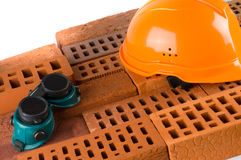 Construction  bricks and helmet Stock Photo