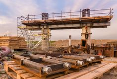Construction Bridge. New bridge getting built with a use of a crain stock photo