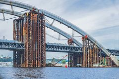 Construction of a bridge over the river. Temporary metal construct. Construction of a bridge over the river. Metal construct royalty free stock image