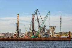 Construction of a bridge over the river Stock Image