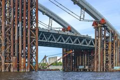 Construction of a bridge over the river. Temporary construct. Construction of a bridge over the river. Temporary metal construct stock images