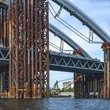 Construction of a bridge over the river. Temporary construct. Construction of a bridge over the river. Temporary metal construct stock photos