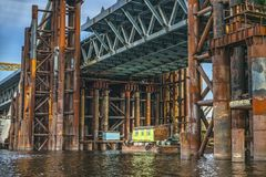 Construction of a bridge over the river. Temporary construct. Construction of a bridge over the river. Temporary metal construct stock photography