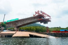 Construction of a bridge in progress. With small ferry jetty on the front Stock Images