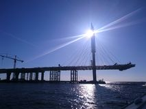 Construction of the bridge in St. Petersburg, a clear day, the view from the water stock photos