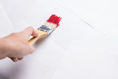 Construction brush in hand on white background. not isolated. Copy space royalty free stock photos