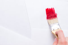 Construction brush in hand on white background. not isolated Royalty Free Stock Photos