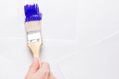 Construction brush in hand on white background. not isolated Stock Photography