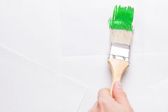 Construction brush in hand on white background. not isolated Royalty Free Stock Images
