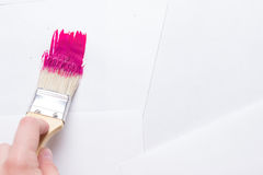Construction brush in hand on white background. not isolated. Copy space royalty free stock image