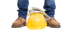 Construction builder feet, helmet and gloves Royalty Free Stock Photography