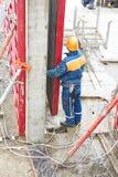 Worker disassemble falsework construction Royalty Free Stock Image