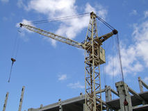 Construction of a building 2. The building crane working on construction of a building under the blue sky Stock Images