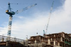 Construction of building. Construction site of a building with crane Stock Photo